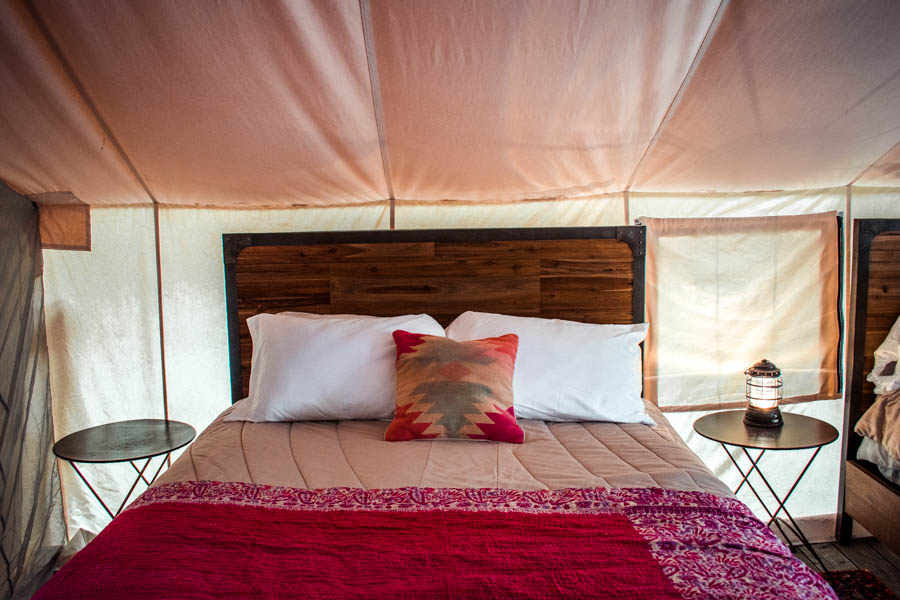 Bed at Firelight Camps in Ithaca