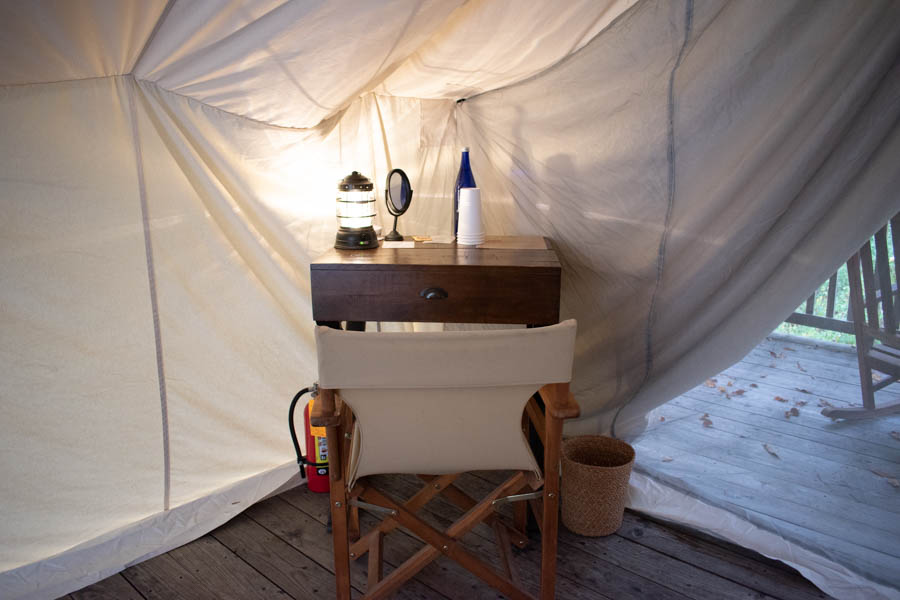 Desk in tent at Firelight Camps in New York